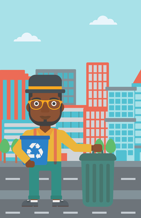 An african-american man standing with a recycle bin in hand and another bin on the ground on a city background vector flat design illustration. Vertical layout.
