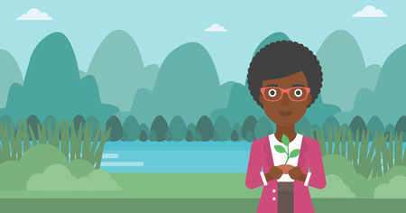 An african-american woman holding in hands a small plant in soil on the background of landscape with mountains and river vector flat design illustration. Horizontal layout. Illustration