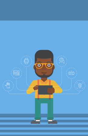 An african-american man holding a tablet computer and some icons connected to the device on a light blue background vector flat design illustration. Vertical layout.