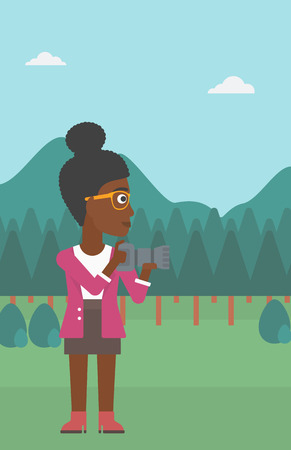 An african-american woman taking photo on the background of green forest and mountains vector flat design illustration. Vertical layout.