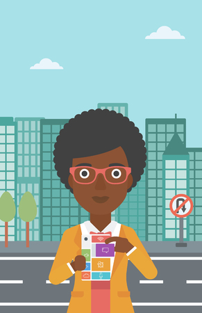 An african-american woman holding modular phone. Woman with modular phone standing on a city background. Woman using modular phone. Vector flat design illustration. Vertical layout. Ilustração