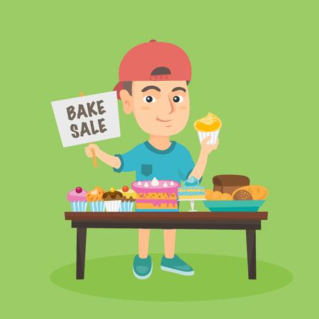 Pequeño muchacho caucásico que funciona la caridad coció venta. Sonriente niño de pie en la mesa con dulces y la celebración de magdalena y la placa con el texto hornear venta.