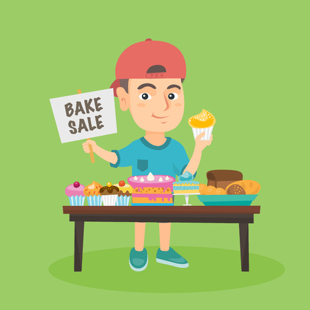 Little caucasian boy running charity bake sale. Smiling boy standing at the table with sweets and holding cupcake and plate with text bake sale.