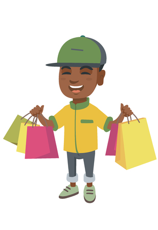 Happy african boy holding shopping bags. Young smiling boy carrying shopping bags.