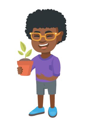 African-american smiling boy holding a potted plant in hand. Full length of happy boy laughing and holding a flower in a pot.