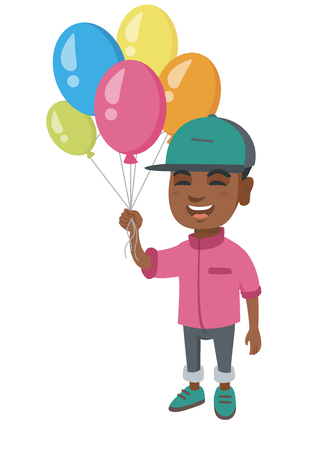 African-american smiling happy boy with the bunch of colorful air balloons in his hand.