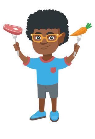 African-american boy holding forks with organic carrot and steak. Full length of little boy with carrot and meat steak in hands.