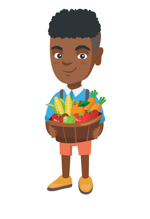 African smiling boy with the basket of fruit and vegetables. Full length of little boy holding the basket with fruit and vegetables.