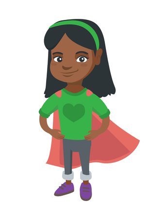 African-american brave girl wearing superhero costume. Cheerful superhero girl in red cloak standing with hands on her waist.