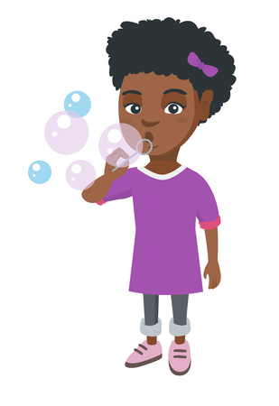 Little african-american girl blowing soap bubbles. Girl making soap bubbles. Girl playing with soap bubbles.