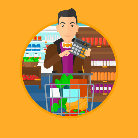 checking: Young man at the supermarket with calculator and supermarket trolley full with products. Man checking prices with calculator. Vector flat design illustration in the circle isolated on background.