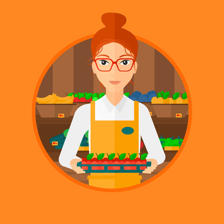 mujer en el supermercado: Female supermarket worker holding a box with apples. Female young supermarket worker carrying box with fruits in supermarket. Vector flat design illustration in the circle isolated on background.