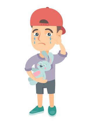 wiping: Caucasian boy in a cap crying and wiping the tears away. Little boy crying and holding toy rabbit in hand. Vector sketch cartoon illustration isolated on white background.