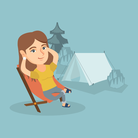 Young caucasian woman sitting in a folding chair on the background of camping with a tent.
