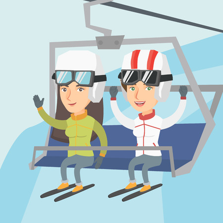Caucasian skiers sitting on ski elevator with raised hands.