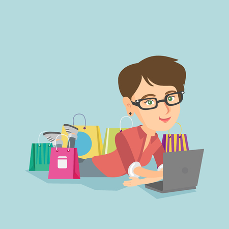 Young caucasian woman using a laptop for online shopping. Smiling woman lying with a laptop and shopping bags around her. Woman doing online shopping. Vector cartoon illustration. Square layout.