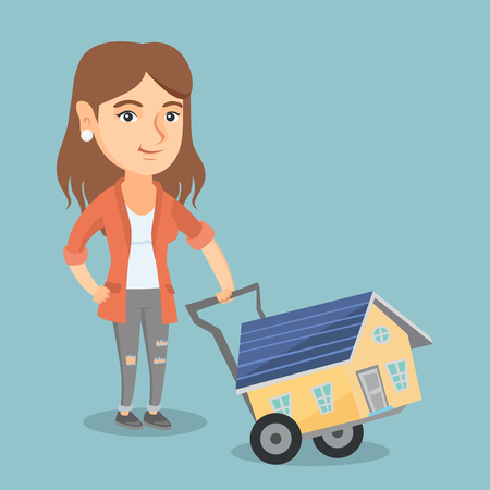 Young caucasian woman pushing a trolley with a house. Happy woman using a trolley to transport a house. Smiling woman buying a new house. Vector cartoon illustration. Square layout. Illustration