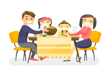 Cheerful multiethnic family sitting around the table and eating dinner.