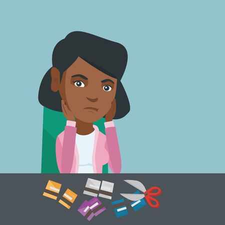Disappointed african-american business woman cutting credit cards with scissors.