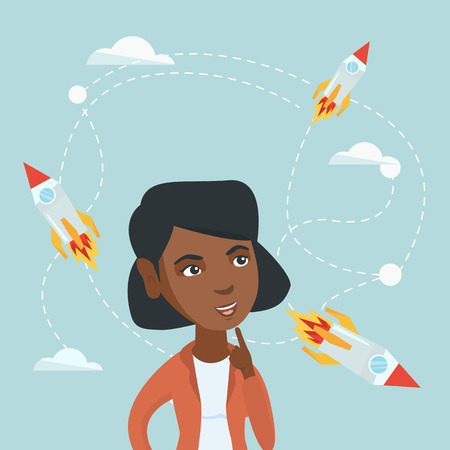 African-american business woman looking at flying start up rockets.