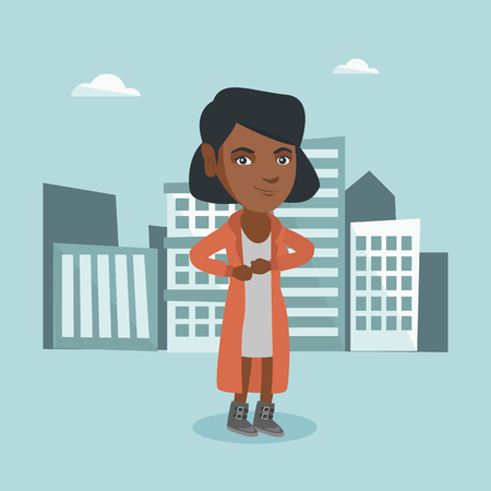 Young african-american business woman standing on the city business buildings.