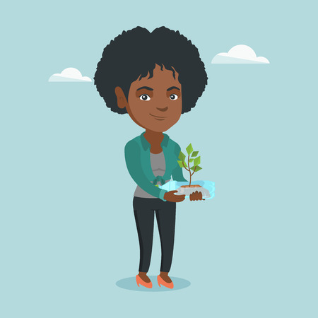 Young african-american woman holding plastic bottle with plant growing inside.