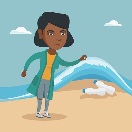 Afrikanerin, die Plastikflaschen unter Meerwasser zeigt. Standard-Bild - 90227752