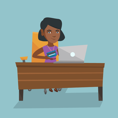 Young african woman sitting at the table with a laptop and holding a credit card. Illustration