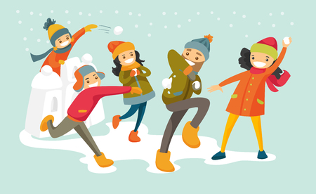 Young happy family playing snowball fight and having fun in snow in winter.