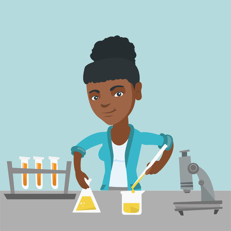 African-american student carrying out laboratory experiment. Young happy student working with a microscope and laboratory equipment with chemical liquid.