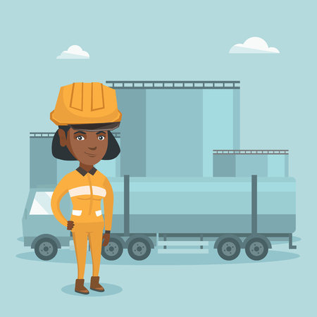 Young African refinery worker of oil and gas industry standing on the background of fuel truck and oil refinery plant. Woman working at refinery plant.