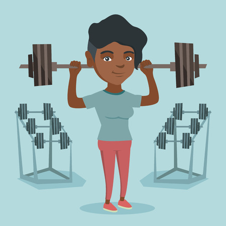 African-american sporty woman lifting a heavy weight barbell. Strong sportswoman doing exercise with a barbell.