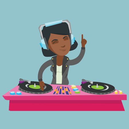 Young african-american DJ mixing music on vinyl turntables.