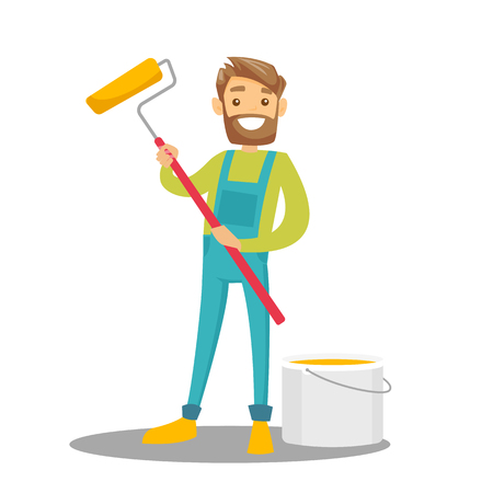 Young cheerful caucasian white hipster painter in uniform holding a paint roller in hand while standing near the bucket with yellow paint. Vector cartoon illustration isolated on white background.