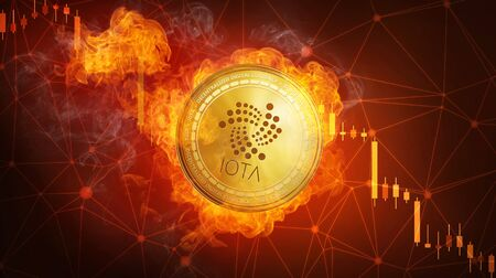 Golden IOTA coin in fire flame is falling. Burning crypto currency IOTA falling down, blockchain cryptocurrency market crash bubble burst concept with down chart. Stock Photo