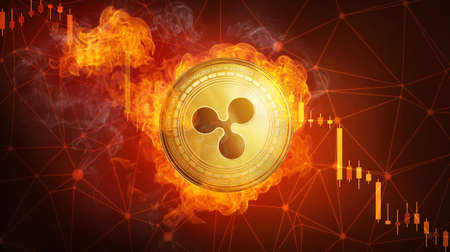Golden Ripple coin in fire flame is falling. Burning crypto currency Ripple falling down, blockchain cryptocurrency market crash bubble burst concept with down chart. Stock Photo