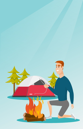 Young Caucasian white man with a wooden stick in his hand sitting near the campfire and enjoying the atmosphere. Man making the campfire. Vector cartoon illustration. Vertical layout.