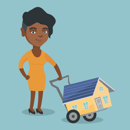 Young african-american woman pushing a trolley with a house. Happy woman using a trolley to transport a house. Woman buying a new house. Vector cartoon illustration. Square layout.