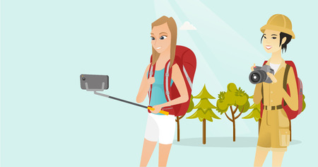 Young multiethnic happy female travelers making selfie. Smiling caucasian white and asian women with backpacks taking selfie photo with a mobile phone. Vector cartoon illustration. Horizontal layout.