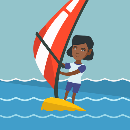 Young African American Woman Windsurfing In The Sea Standing On Board With