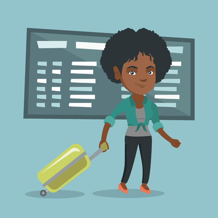 Young african-american passenger with suitcase walking on the background of schedule board at the airport. Business woman pulling suitcase at the airport.