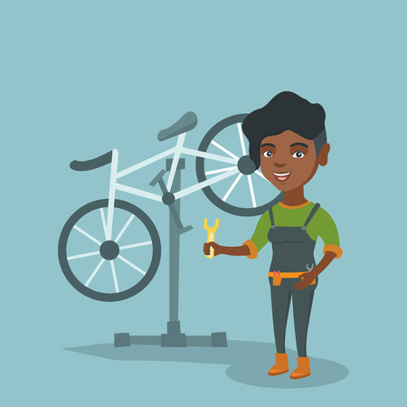 Young african-american bicycle mechanic showing a spanner on the background of broken bicycle. Technician repairing bicycle in repair shop. Vector cartoon illustration. Square layout.