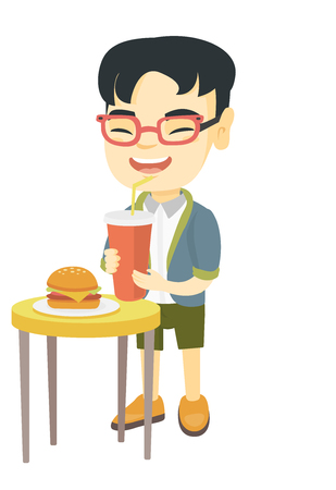 Little asian laughing boy drinking soda and eating cheeseburger. Smiling boy standing near the table with fast food. Vector sketch cartoon illustration isolated on white background.