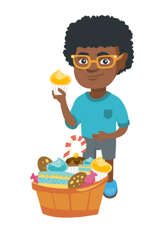 Little african-american boy holding a yummy cupcake and stroking his belly. Happy boy standing near the bowl full of sweets. Vector sketch cartoon illustration isolated on white background.