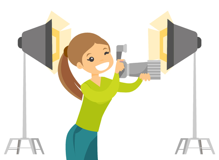 Young caucasian white photographer holding a camera in photo studio with lighting equipment. Photographer using a professional camera in photo studio. Vector cartoon illustration. Horizontal layout. Stok Fotoğraf - 98048492