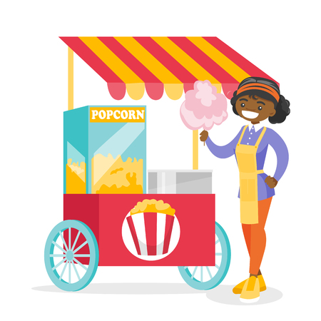 Young cheeerful african-american street seller standing next to the cart with cotton candy and popcorn. Small business and fast food concept. Vector cartoon illustration isolated on white background. Stock Illustratie