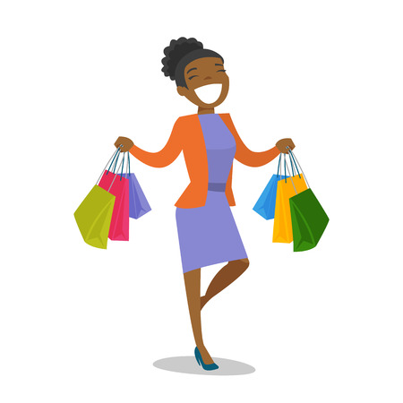 Happy african-american woman carrying shopping bags. Young woman holding a lot of shopping bags.