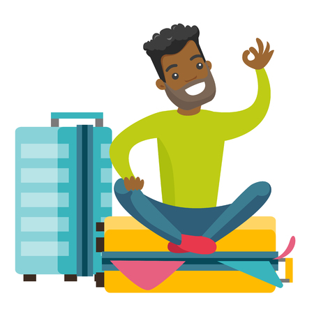 Young african-american man sitting on a suitcase full of clothes and trying to close it. Happy man packing a lot of clothes into a single suitcase and showing ok sign. Vector cartoon illustration.