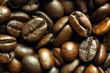 Macro closeup of medium roasted coffee bean of Ethiopian origin suitable for all methods of brewing, top view