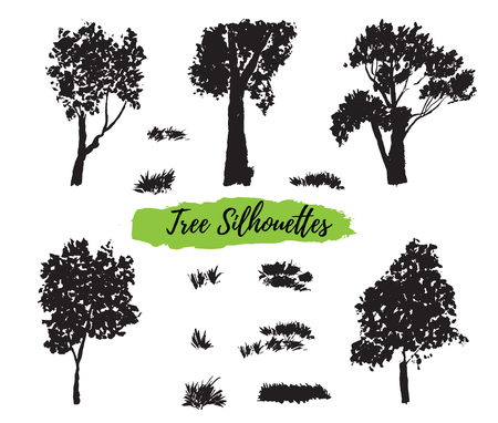Collection of silhouettes of trees and herbs, hand-painted with watercolors on white background. The vector format.
